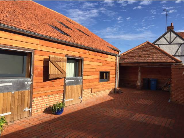 42 Larch Feather Edge Cladding by Co2 Timber