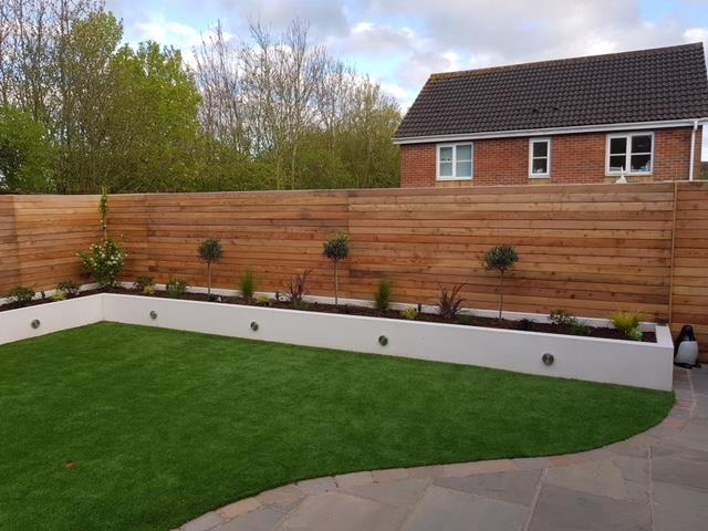 78 UK larch fencing by CO2 Timber