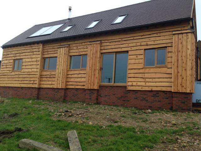 Co2 waney edge western red cedar cladding